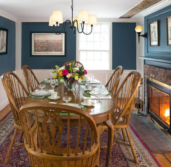 Dining room with fireplace at our bed and breakfast in Kennebunkport