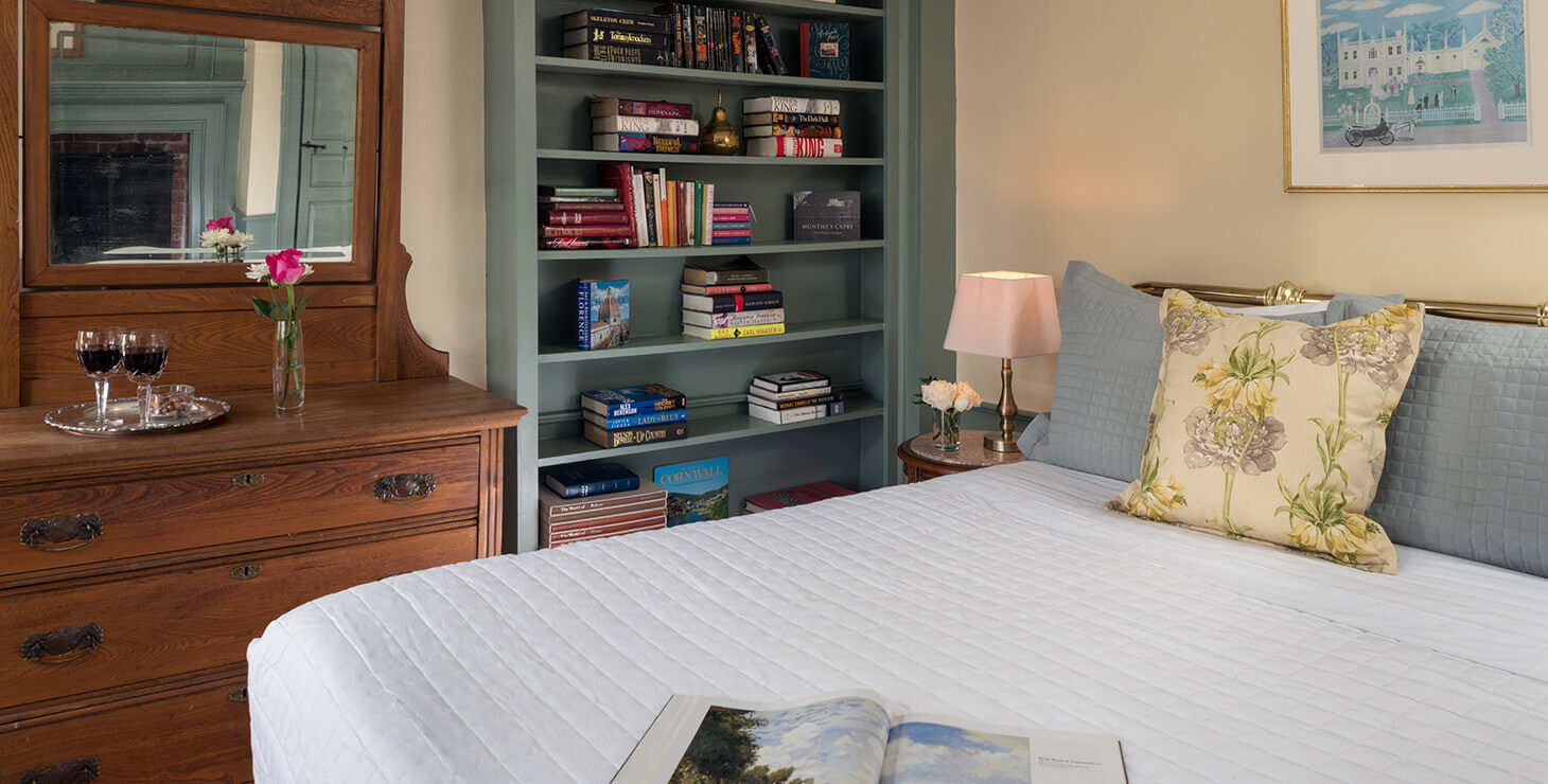 Ralph's Library bed and fireplace at our bed and breakfast in Kennebunkport