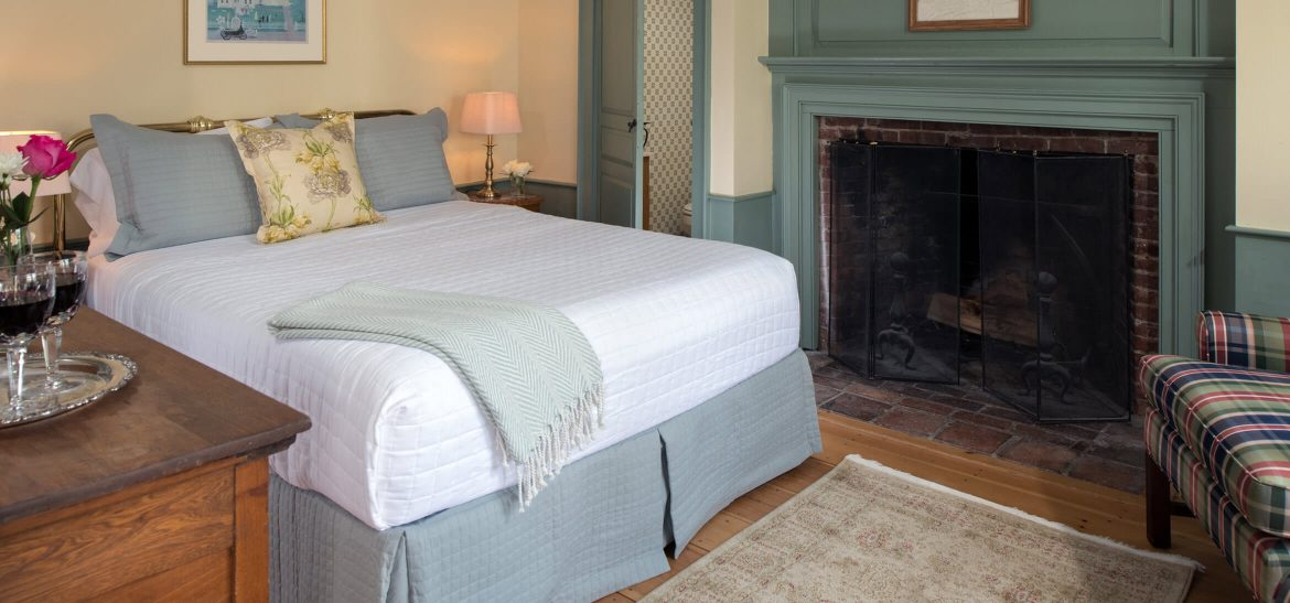 Ralph's Library bed and fireplace at our Kennebunkport B&B