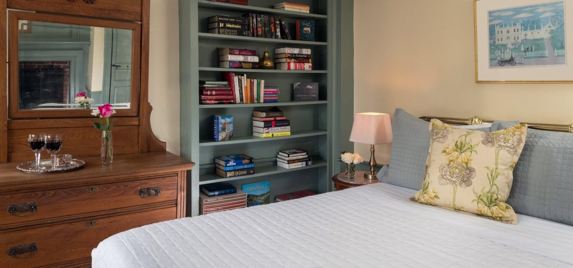 Ralph's Library bed and bookshelf at our Kennebunkport, Maine B&B