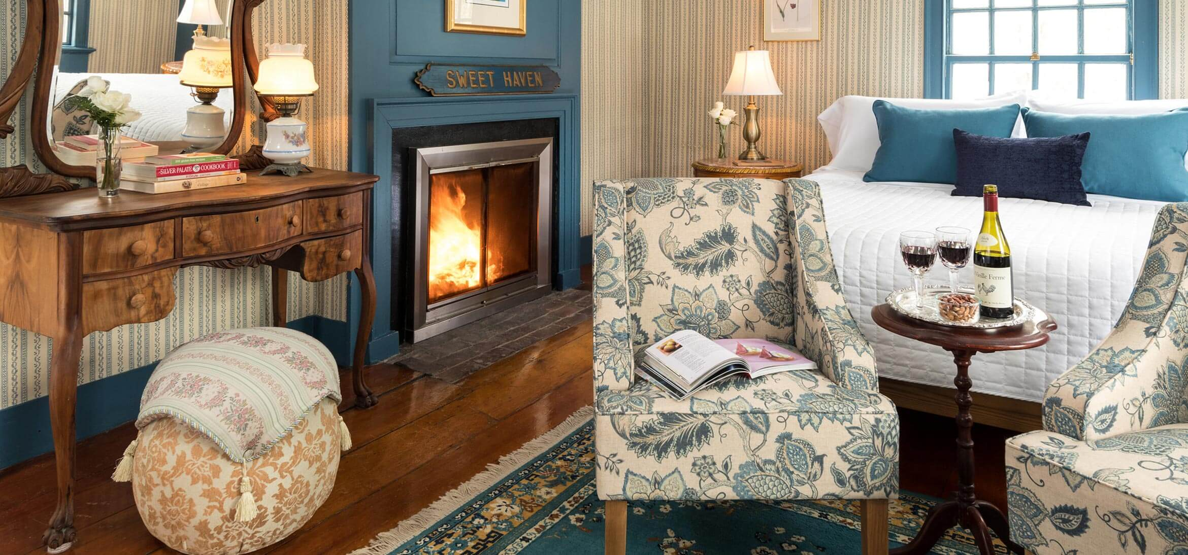 Sweet Haven Room bed, chairs and fireplace at our Kennebunkport, Maine B&B