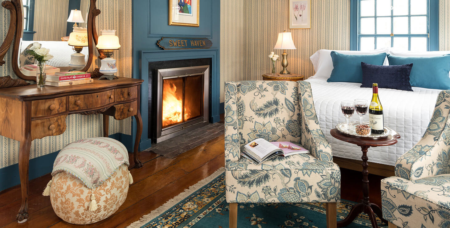 The bed and fireplace in Sweet Haven at our Kennebunkport B&B
