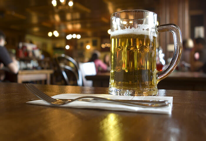 Glass of beer on a table at a restaurant