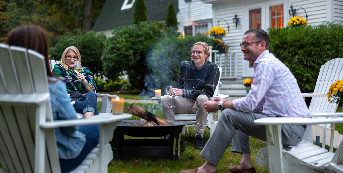 People having fun around the fire pit at our romantic Kennebunkport bed and breakfast
