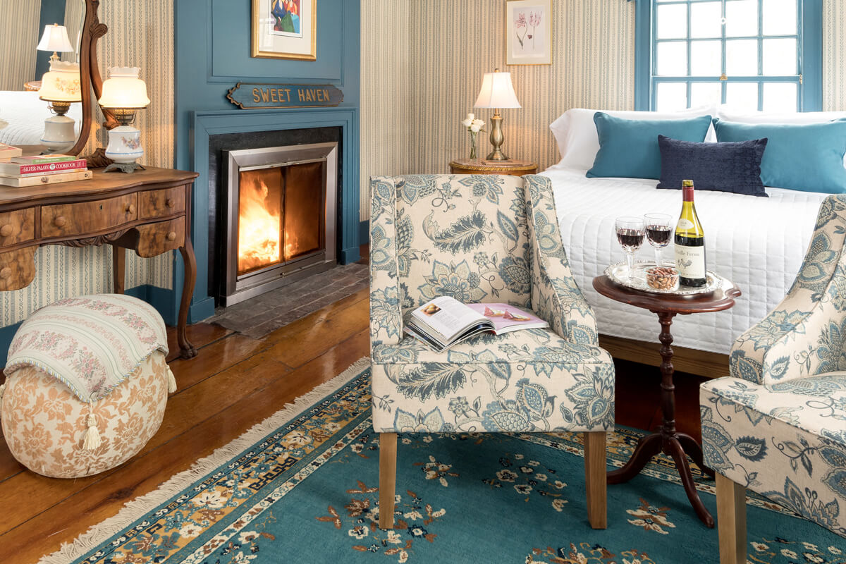 Cozy accommodations at Waldo Emerson Inn, room with a fireplace